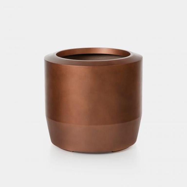 Holly Hunt Fugu large hollow cast concrete outdoor planter in copper finish  Fugu Planter Sz 1, Copper  Additional Information: Material: Hollow Cast Concrete Finish: Copper Dimensions: Ø 24.5 x 22.75 H inch Available in other finish