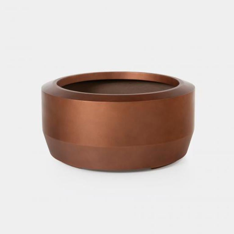 Holly Hunt Fugu small hollow cast concrete outdoor planter in copper finish  Fugu Planter Sz 2, Copper  Additional Information: Material: Hollow Cast Concrete Finish: Copper Dimensions: Ø 30 x 14.25 H inch Available in other finish options: