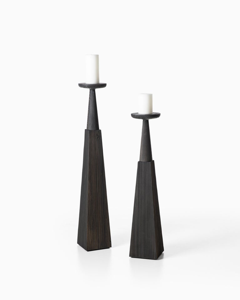 Inspired by candlesticks found in a catherdal and made of solid spruce with metal, these substantial candles provide a reverent yet calming ambiance. Brushed spruce, black tinted.  Additional Information: Material: Brushed spruce, black tinted