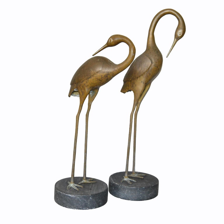 A pair of vintage bronze Asian inspired crane sculptures on black-gray marble bases. No markings. Can be used for indoors and outdoors.