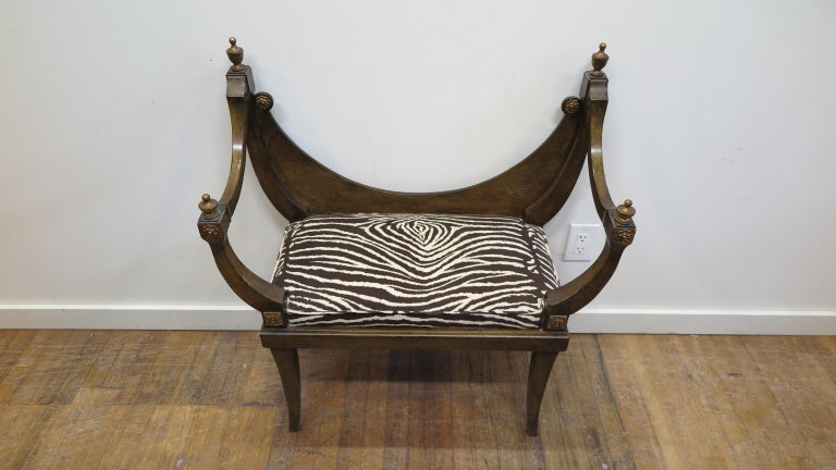 Midcentury Hollywood Regency bench seat. Throne style bench with suede Zebra fabric. Gilt carved details of florets with urn topped arms. Seat height 18.5 inches, seat opening is 21.5, seat width in middle is 24 inches. Upholstery is recent. Very