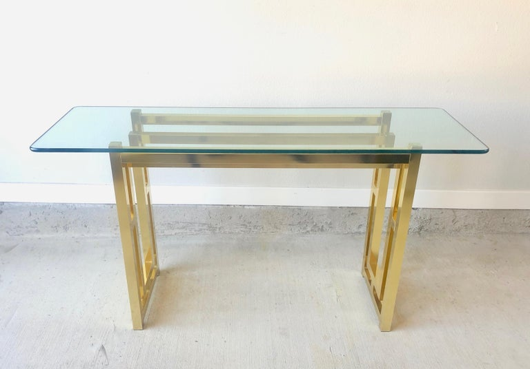 Hollywood Regency brass console table.