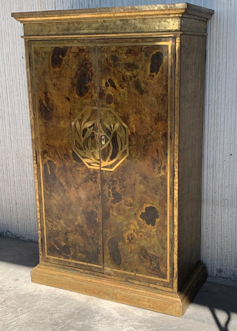 Mid-Century Modern drinks bar cabinet with nice brass faces with hammered brass nails, panels in a solid wood frame.