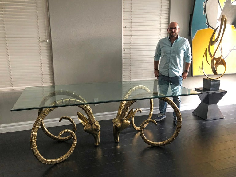 This table is absolutely breathtakingly beautiful and is has to be one of the most bespoke objects our gallery has ever acquired. Attributed to Alain Chervet, these heavy brass ibex, or ram's head dining table bases are functional works of art. The