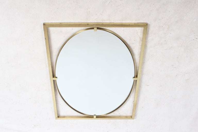 Oval mirror in the Hollywood Regency style by John Widdicomb, circa 1960s. Rectangle brass frame with oval mirror and brass edge. Shown with original patina, can be polished. No label. In the style of Mastercraft.