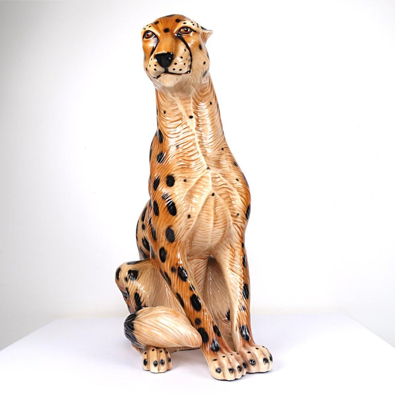 Beautiful statue of a sitting jaguar made of ceramic that is most probably cast and hand painted. Attributed to Ronzan, the Italian specialist in this field.