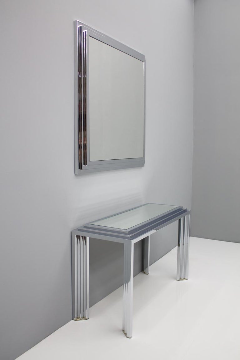 Fantastic mirror and the matching console table from France, 1974. The console table and the mirror each have a new mirror  Measurements console table: W 39.4