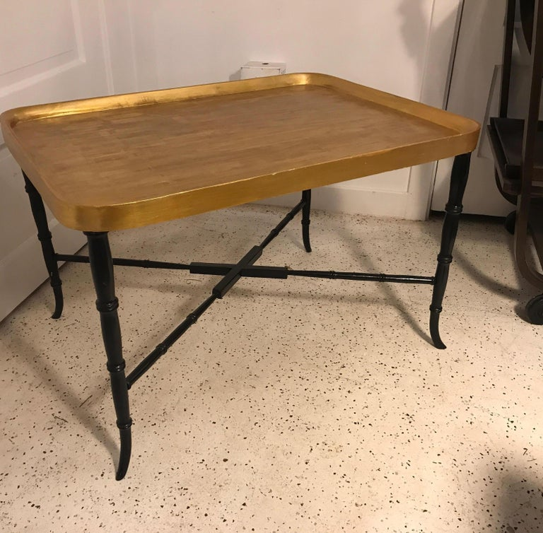 Elegant gilt topped tray style table with ebonized legs. The tray top is attached and not removable. The base with faux bamboo style legs with stretcher base. Very chic and Classic design, Italy, 1960s.