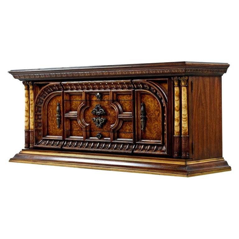 This burl wood adorned dresser reminds us of the phenomenal architecture possessed by the great monuments from Greek antiquity which adorn the Acropolis. The aged brass handles and faux ivory pillars add a splash of glitz and glamour which further