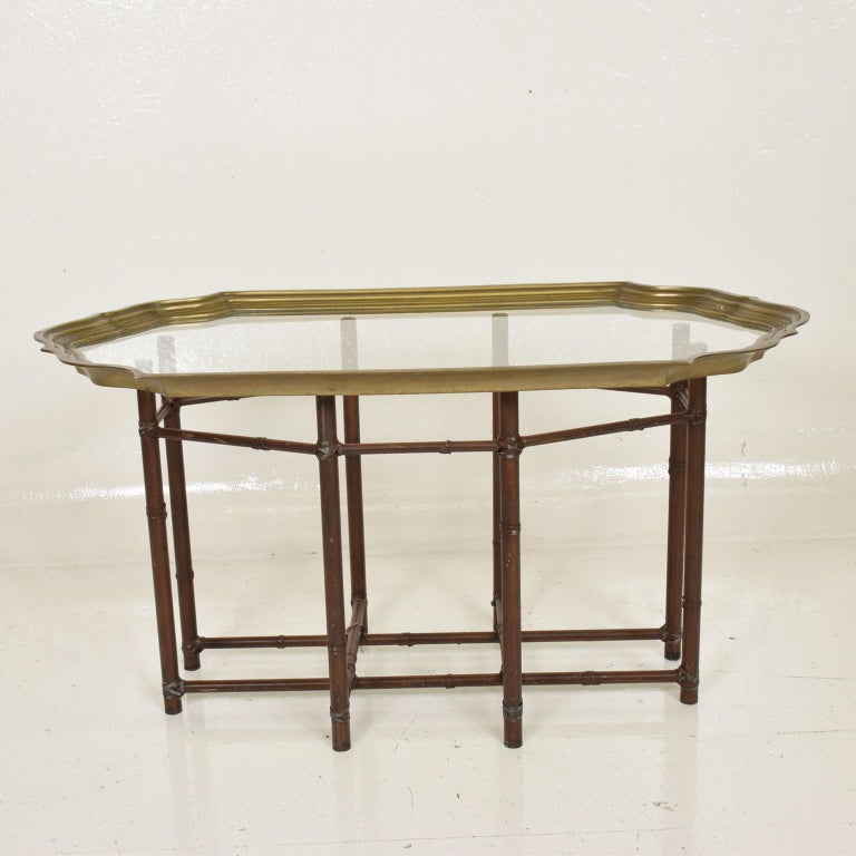 For your consideration, a Hollywood Regency faux bamboo coffee table with brass and glass top.  Made in the USA, circa the 1970s.  Dimensions:37 1/2