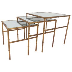 Hollywood Regency Faux Bamboo Gilt Metal Nesting Tables, circa 1960s
