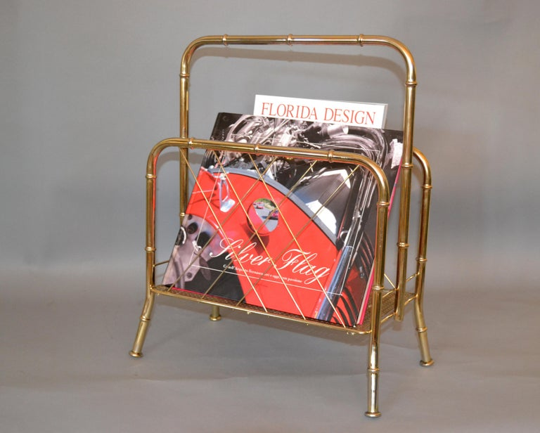 Hollywood Regency faux brass bamboo and cane magazine rack. The magazine and book is just for decoration. Simply lovely.