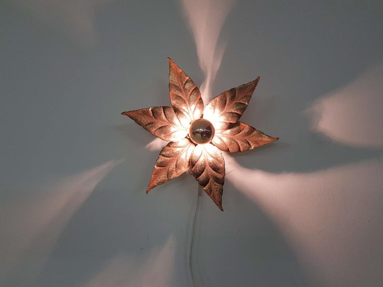 Fantastic wall or ceiling light in the shape of a flower. The lamp features a flower connected to a wall or ceiling plate. In the middle of the golden flower, there is a bulb with a golden reflector. This bulb comes with the purchase.  This golden