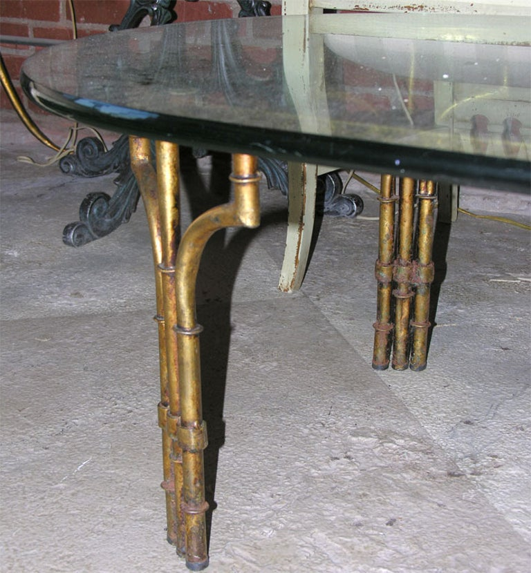 Iron faux bamboo coffee table with glass top, gilt finish. Can be boxed and shipped without glass top.