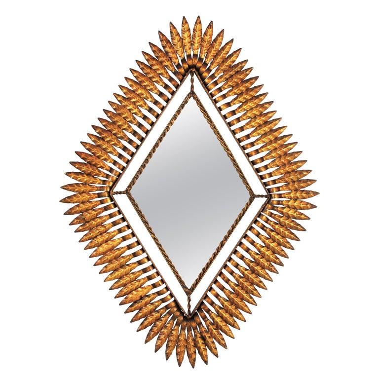 Hollywood Regency Gilt Iron Leafed Rhombus Sunburst Mirror, Spain, 1950s For Sale