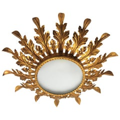 Hollywood Regency Gilt Iron Leafed Sunburst Light Fixture with Frosted Glass