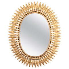 Hollywood Regency Gilt Metal Oval Sunburst Mirror, Spain, 1950s