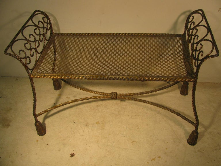 Exceptional gilt iron rope and tassel bench. Many places to use this wonderful piece, bedroom, vanity, by a window.