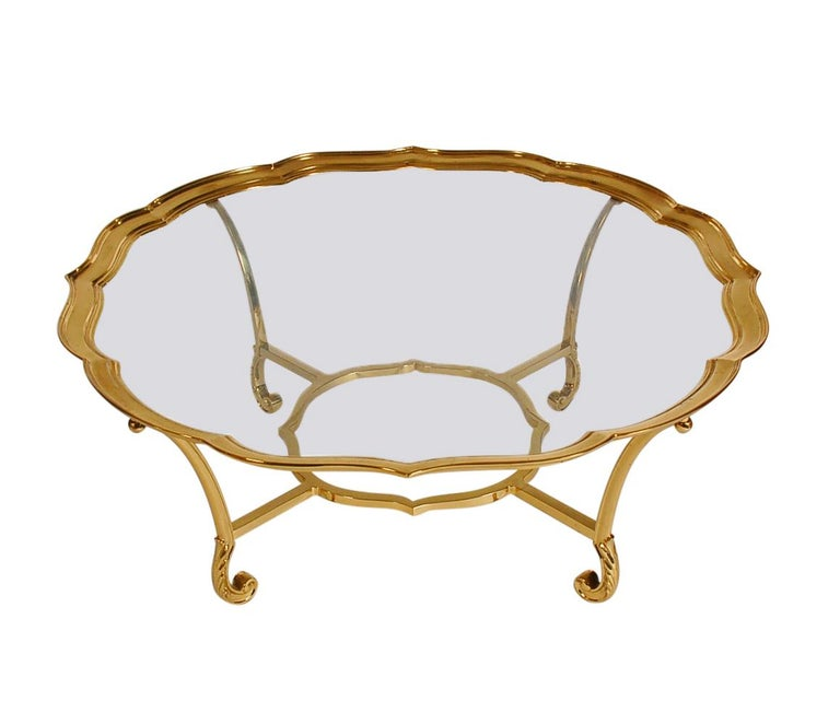 A high quality and elegant design made by LaBarge in France in the 1970s. It features heavy solid brass construction with inlayed glass top.