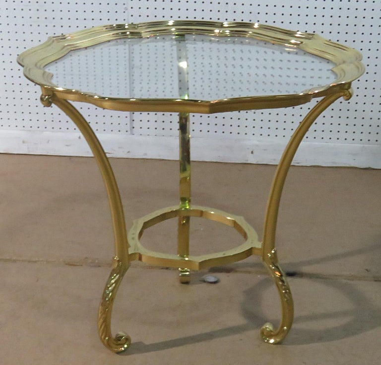 This is a gorgeous Hollywood Regency brass and glass top coffee table with a scalloped edge, attributed to Labarge. This table is the epitome of LaBarge's talent in designing glamorous furniture without going off the proverbial cliff and drifting