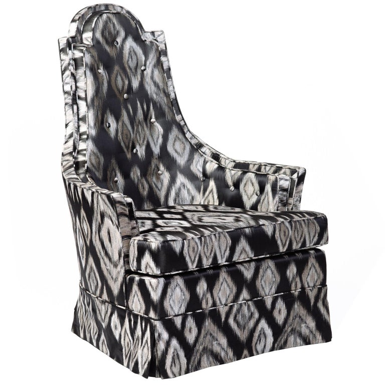 Mid-Century Modern with sculptural high back design. Upholstered in graphic black and platinum geometric silk fabric with Ikat print. Chair has tall throne shield shape backs with a gorgeous profile. Features button back accents and self-welt
