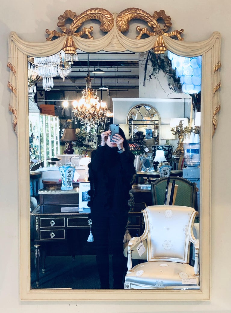 Hollywood Regency Grosfeld House painted vanity and matching mirror. In a word Magnificent. This recently decorated linen white desk or vanity by Grosfeld House has a matching mirror. The overall off white slighted aged finish with clay under the