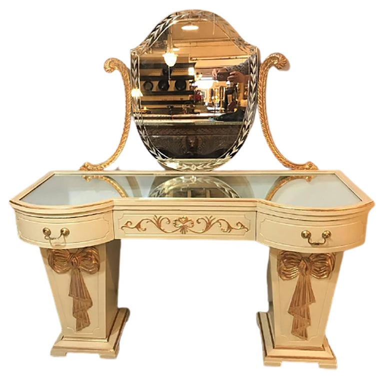 Grosfeld House parcel paint and gilt decorated vanity or desk with mirror. A fine one of a kind ribbon and tastle solid wood carved writing desk or ladies vanity. The tiered square base sitting on feet leading to a column-form pair of doors with