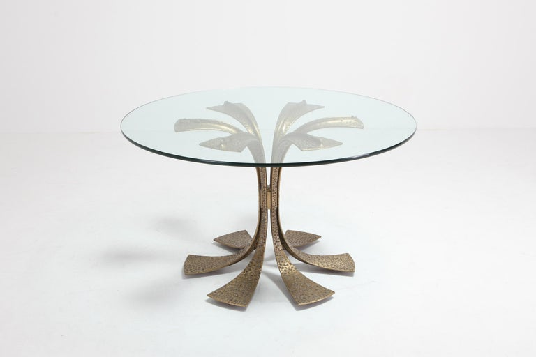 Brass dining table with a clear glass top by Luciano Frigerio.  Fits well in an eclectic Hollywood Regency inspired interior.  Frequent visits to prestigious craftsmen's studios like Canturine, where he often met Masters like Gio' Ponti, Franco