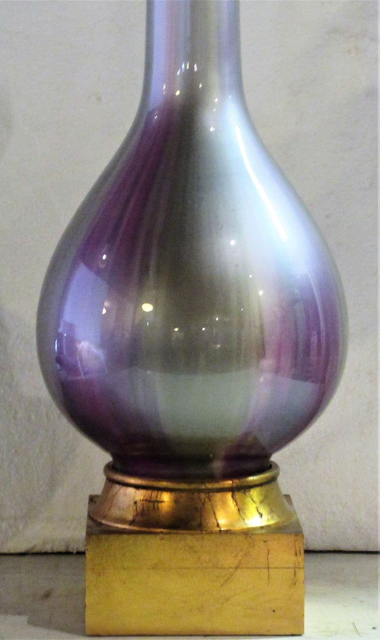 Hollywood Regency silver gray lavender purple iridescent glass lamp with giltwood base by Frederick Cooper, Chicago, circa 1960-1970. A beautiful lamp with a tall elegant form. Look at all pictures and read condition report in comment section.