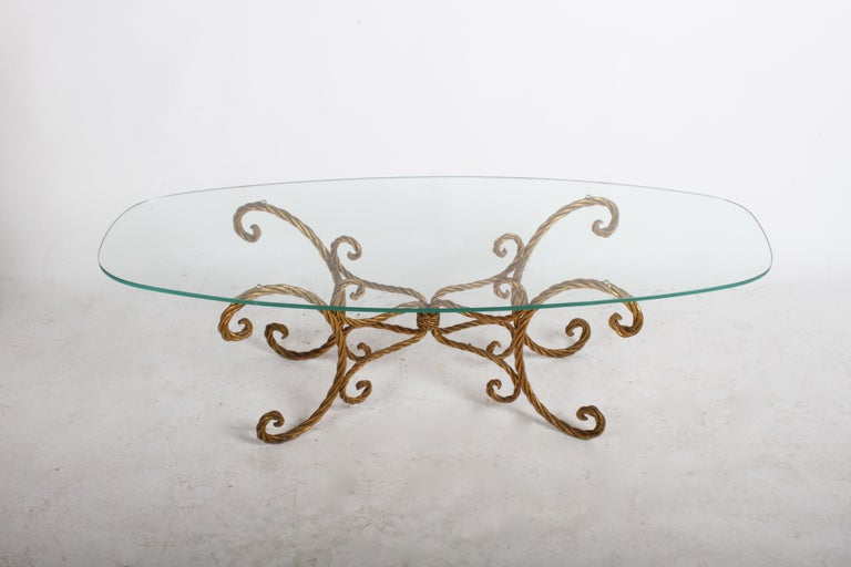 Hollywood Regency or midcentury Italian gilt braided rope coffee table with oval form glass. Original 3/8