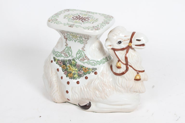 Circa 1960s Hollywood Regency Italian camel garden seat in glazed terracotta with hand painted decoration. In fine condition, no visible damage, unmarked.