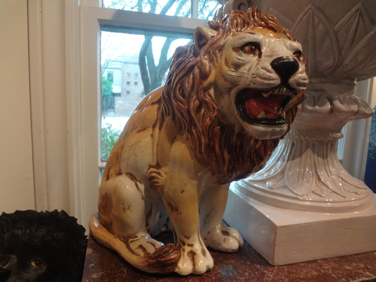 Great Hollywood Regency Italian glazed terracotta lion figure or statue. Realistic Italian glazed terracotta animal sculpture of a lion. Beautiful details.