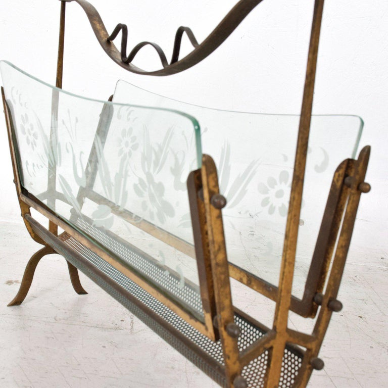 For your consideration a vintage Italian magazine holder or magazine rack constructed with solid brass and two glass inserts with flower etched design.   The lower holding section is perforated metal (painted in dark green color).  Original