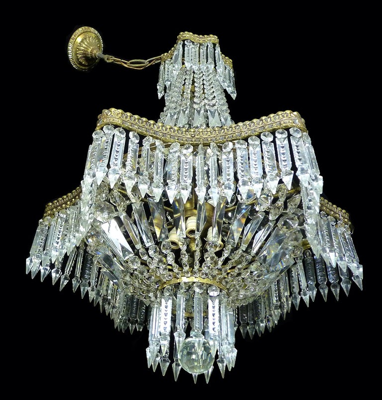 Six-light French Empire crystal basket chandelier with a clean hexagonal gilt bronze frame  Measures: Diameter: 22 in/ 53 cm Height: 43.5 in =30 in + 13.5 in/Chain (110 cm= 75 cm + 35 cm/ Chain) Weight: 22 lb/ 10 Kg Six light bulbs E14, good