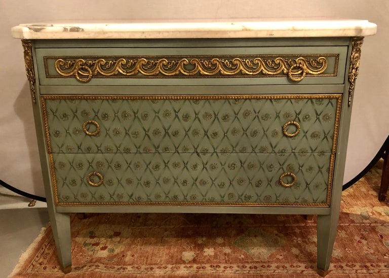 Pair of simply stunning hand painted commodes, nightstands or chests in the manner of Maison Jansen each having a think marble top supported by a spectacular painted center thin drawer having a bronze frame and bronze pulls with a bronze decorated