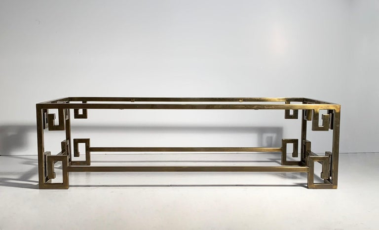 A fairly rare Mastercraft form to come across. Greek key coffee table brass with glass top insert.  The brass finish shows a fair amount of age along with some light scratches. Please request additional photos.