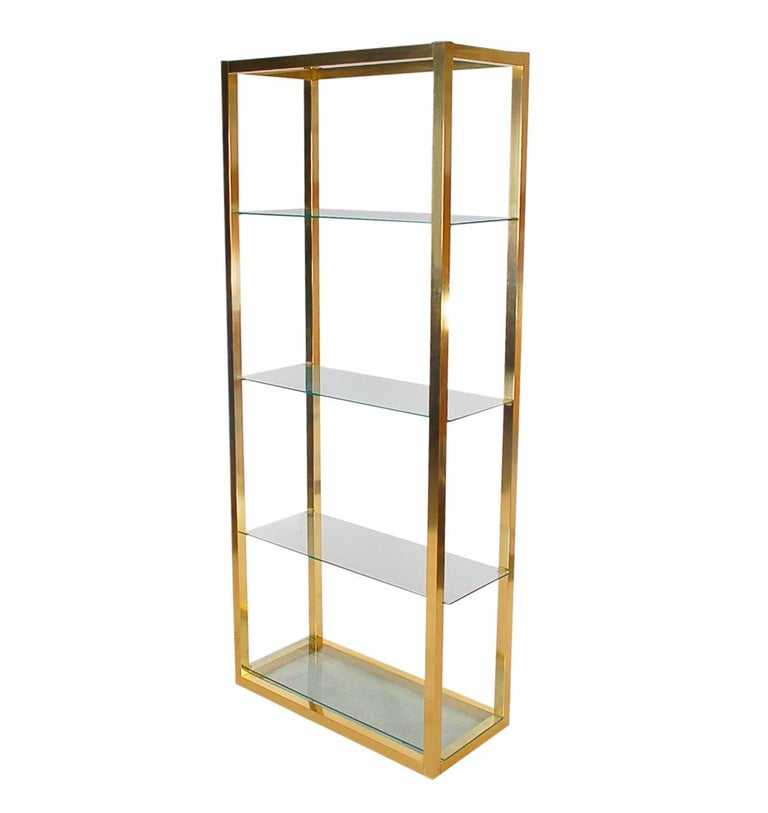 A simple and modern étagère to display your prized possessions. This unit is from the late 1970s or 1980s and is probably Italian. It features brass plating with clear glass shelves.