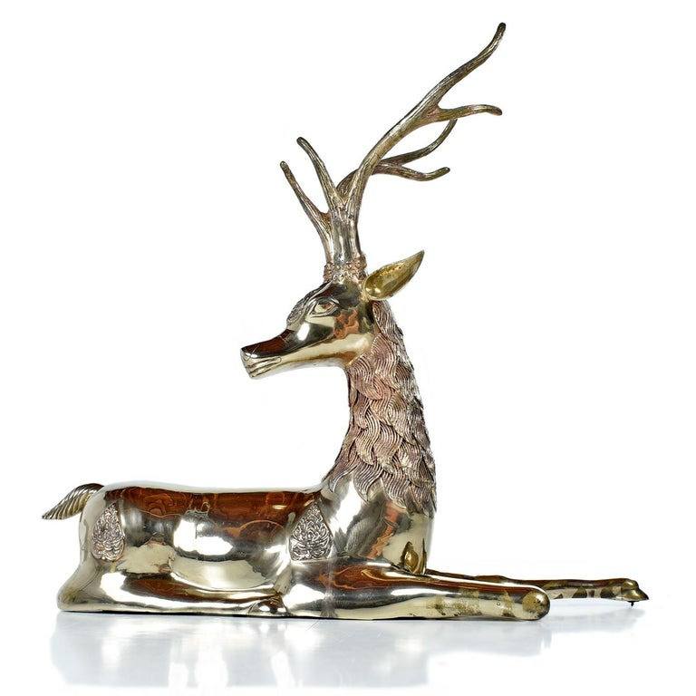 This exceptional seated brass deer is nearly three feet long and is almost just as high! The monumental pieces supplants all brass figurines we've seen from the era. The golden hue sculpture features elaborate details like a finely embellished tufts