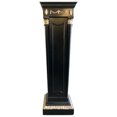 Hollywood Regency Neoclassical Style Pedestal Ebonized and Parcel Gilt Decorated