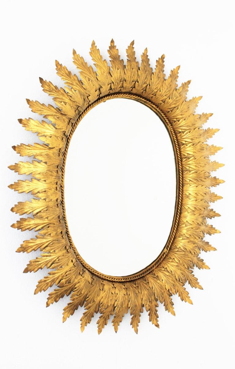 Hollywood Regency Oval Gilt Metal Leafed Sunburst Mirror