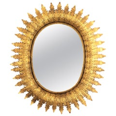 Hollywood Regency Oval Gilt Metal Leafed Sunburst Mirror, Spain, 1950s