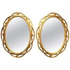 Hollywood Regency Oval Mirrors with Carved Giltwood Frame