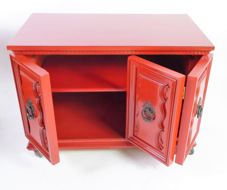 These Hollywood Regency bedside tables or end tables have great scale and are quite usable. They have three doors, one a single and the other a bi-fold opening to an adjustable shelf. All raised on shepherd ball casters making them movable.