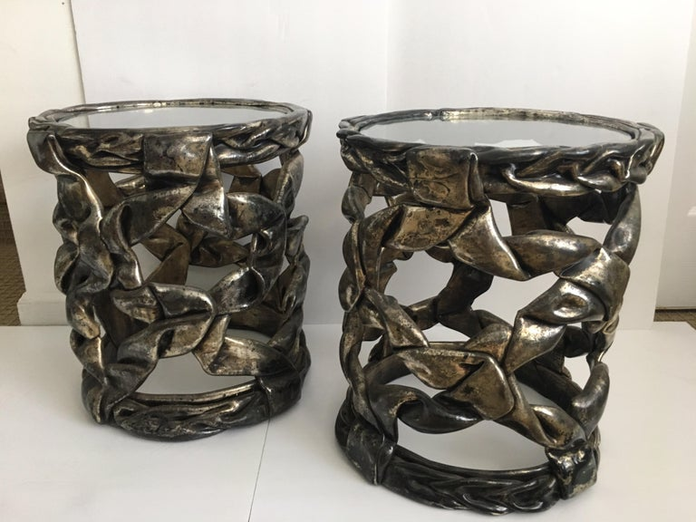 Pair of delicious candy ribbon occasional side tables in the Hollywood Regency style of Tony Duquette. Can be placed together to make an interesting center cocktail table grouping. Original silver leaf finish with natural patina showing gunmetal