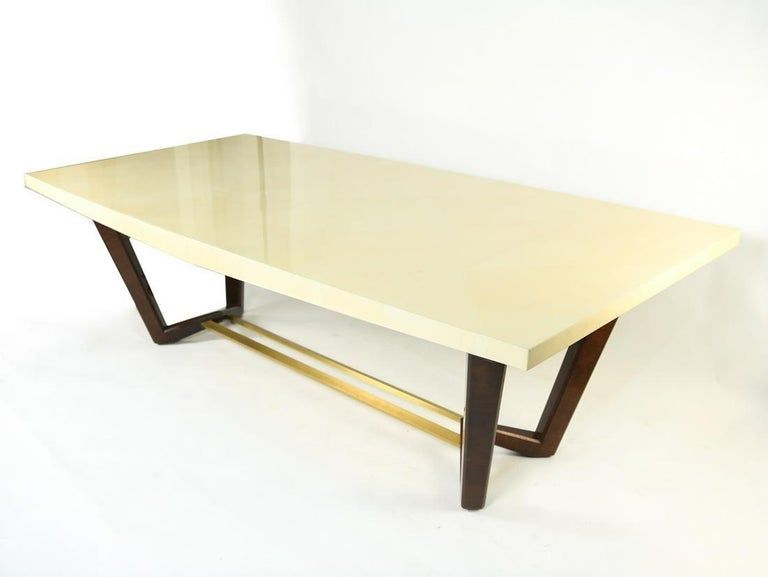 Lorin Marsh Design Sawhorse dining table or conference table. Shown here in a bleached parchment and mahogany base with brushed-brass stretcher. This stunning dining, center or conference table is sure to add sparkle to any room in the home or