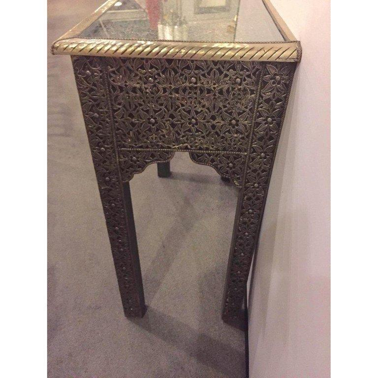 Hollywood Regency style filigree console  Featuring amazingly intricate latticework on brass, the Hollywood Regency console brings a refined, aristocratic ambiance to any room. The two drawers console has a glass top. It can be nicely placed in