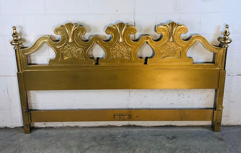 "Hollywood Regency style gold painted wood king size headboard. The headboard has been newly repainted and has lots of interesting detail. Rail holes are 77"" apart. No marks."