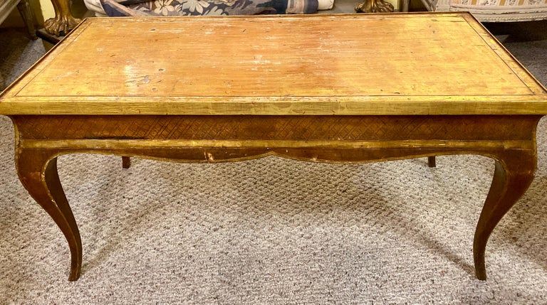 Hollywood Regency style Jansen gilt gold coffee table. The Louis XV Style Coffee Table having all around gilt design with decorative X design. With Brass side pulls.