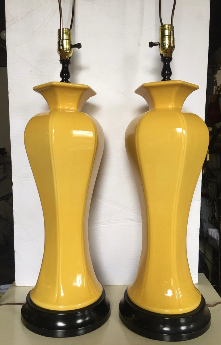 Hollywood Regency Tall Yellow Ceramic Glazed Table Lamps, Pair In Good Condition For Sale In Lambertville, NJ
