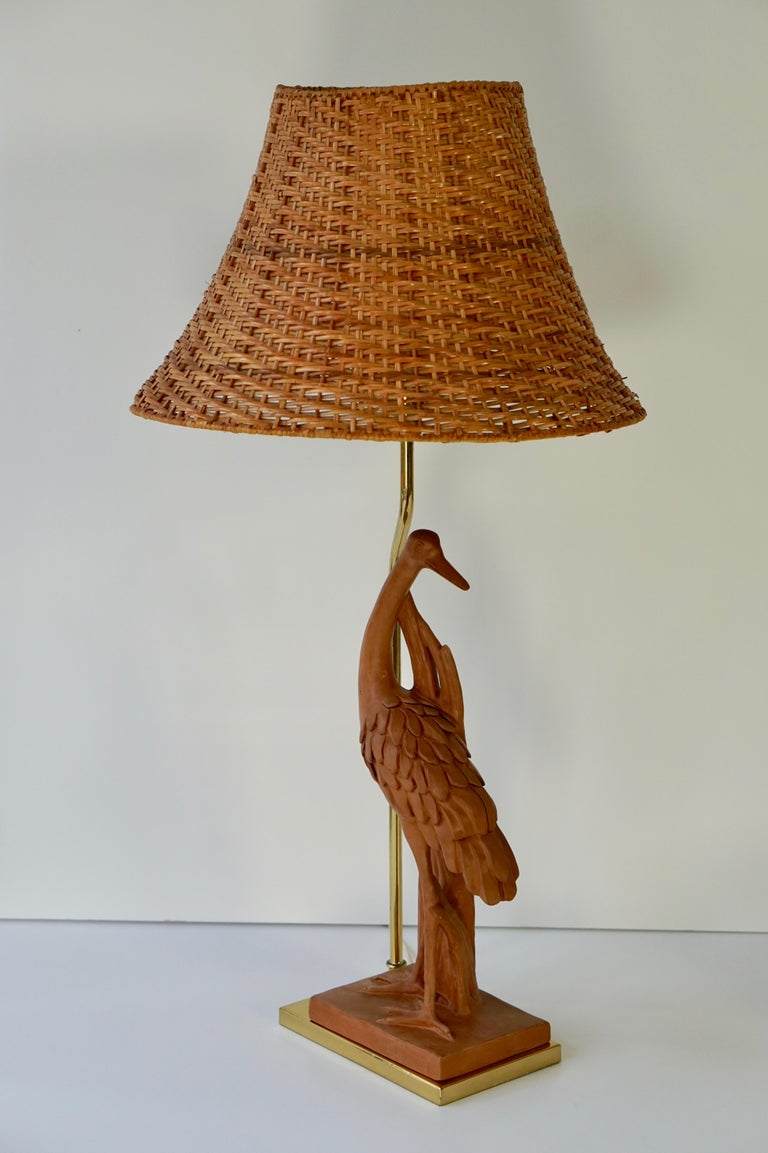 Terracotta Hollywood Regency Heron table lamp by D Sonch. At the focal point of this vintage table lamp stands a heron in terracotta. The exotic subject would suit a wide range of decors and the slender form is perfect for a desk, console, side